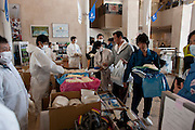 Nuclear Exclusion zone. J-village a footbal resort and training camp become which has become a Radioactive cleanup base for TEPCO (Tokyo Electric Power  Company) .TEPCO  from all over japan workers are handed  protective equipment   for work to clean up contaminated Fukushima  Daichi Nuclear   reactors damaged during the  earthquake /tsunami of march 11th 2011..A feeling of confusion prevailed for many tepco workers from all over japan  who have no  experience with Nuclear contamination cleanup or formal training in the use of protective clothing and equipment.