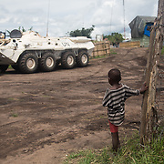 A child is looking at the peacekeepers in the UN base of Bukiringi, Ituri region.