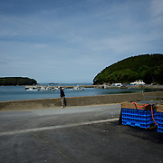May 28, 2013 - Togura, Japan: A man stands by at the fishing port of Togura, a small fishing village in Minami Sanriku, was vastly destroyed by the 2011 tsunami that hit the northeast coast of Japan. Thousands died and hundreds of families lost their houses, business and boats. The recovering community works now in a cooperative system where the few remaining boats, spared by the tsunami, are shared by all. (Paulo Nunes dos Santos)