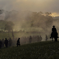 Confederate and Union soldiers advance and fire on each other during a sunrise reenactment of Donelson's Attack, part of a weekend of events commemorating the 150th anniversary of the Battle of Perryville in Perryville, Ky. Saturday October 6, 2012.  Photo by David Stephenson