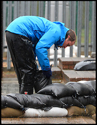 Prince William and Prince Harry lay sandbags in the village of Datchet as they help the communities affected by the floods in the UK. Friday, 14th February 2014. Picture by Andrew Parsons / i-Images