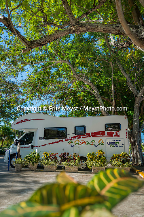 Cuba, November 2018. a great tropical camper spot near Playa Jibacoa. Exploring Cuba with an RV camper is a brand new experience. Cuba is a Caribbean island nation under communist rule. It has sugar-white beaches and is dotted with tobacco fields, which play a part in the production of the country's legendary cigars. The capital, Havana, is lined with pastel houses, 1950s-era cars and Spanish-colonial architecture in the 16th-century core. Photo by Frits Meyst / MeystPhoto.com