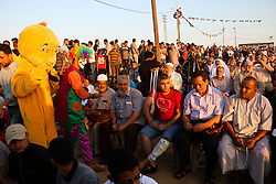 "June 15, 2018 - Palestinian Muslims in Gaza celebrate Eid al-Fitr in the ""Return"" refugee camp along the eastern Gaza border, marking the end of the fasting month of Ramadan. Hamas political bureau chief, Ismail Haniya, and Hamas senior leader, Dr Khalil Al-Hayia, attended the al-Fitr celebrations and performed the Eid al-Fitr prayers alongside the other worshippers in the camp's open square. The ""Return"" refugee camp is located in the northeast of Gaza, close to the Nahal Oz border crossing. Eid al-Fitr is an important religious holiday for Muslims worldwide and it marks the end of Ramadan, which is the holy month of fasting in Islam (Credit Image: © Ahmad Hasaballah/IMAGESLIVE via ZUMA Wire)"
