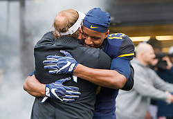Dec 3, 2016; Morgantown, WV, USA; West Virginia Mountaineers cornerback Rasul Douglas (13) hugs West Virginia Mountaineers head coach Dana Holgorsen during senior day ceremonies before their game against the Baylor Bears at Milan Puskar Stadium. Mandatory Credit: Ben Queen-USA TODAY Sports