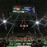 Gymnastics - Olympics: Day 3   Hao You #119 of China performing his Still Rings routine during the Artistic Gymnastics Men's Team Final at the Rio Olympic Arena on August 8, 2016 in Rio de Janeiro, Brazil. (Photo by Tim Clayton/Corbis via Getty Images)<br /> <br /> (Note to editors: A special effects starburst filter was used in the creation of this image)