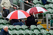 Umbrellas are up as rain stops play during the opening day of the Specsavers County Champ Div 1 match between Somerset County Cricket Club and Hampshire County Cricket Club at the Cooper Associates County Ground, Taunton, United Kingdom on 11 May 2018. Picture by Graham Hunt.