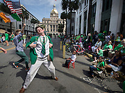 Lamar Lester III dances while marching with the Doherty Clan during the 191st St. Patrick's Day parade, Tuesday, March 17, 2015, in Savannah, Ga. Organizers have long billed the Savannah St. Patrick's Day parade as the nation's second largest based on the size of the procession, rather than the number of people watching. (AP Photo/Stephen B. Morton)