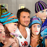 MACAU, CHINA - JUNE 11:  Singer Peter Andre poses with Cirque Du Soleil members at the green carpet during the 2009 International Indian Film Academy Awards at the Venetian Macao-Hotel-Resort on June 11, 2009 in Macau.  Photo by Victor Fraile / studioEAST
