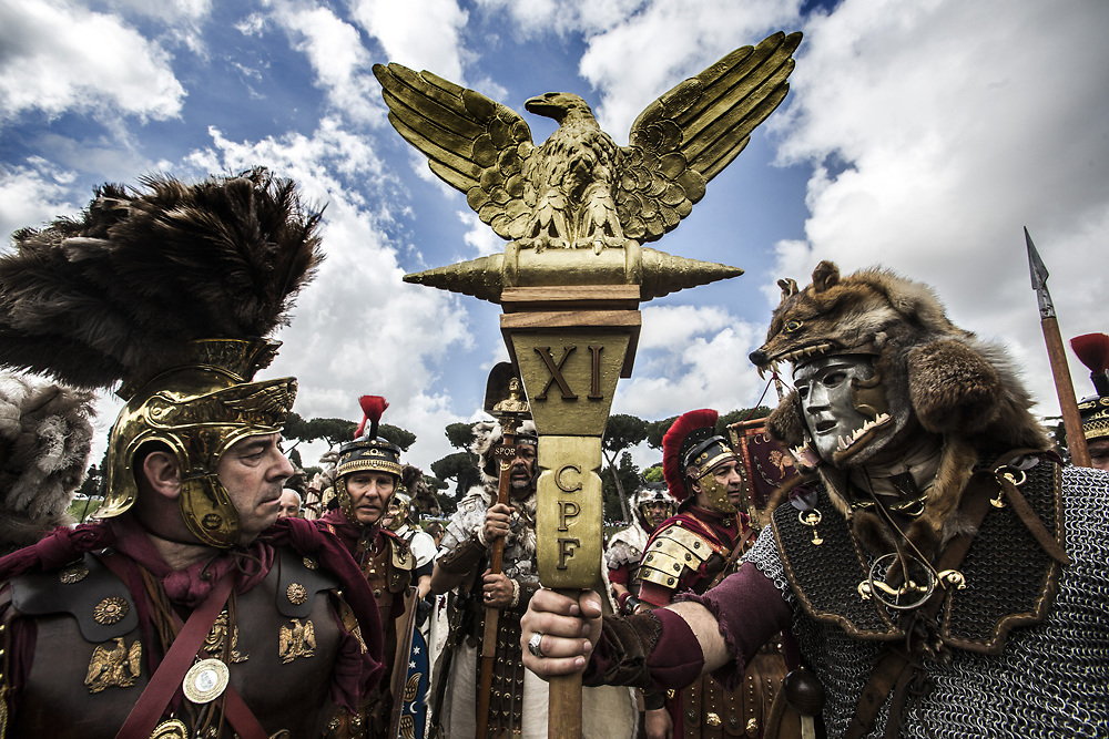 Men and Women dressed as ancient centurions and romans, parade near the Colosseum to commemorate the birth of Rome in in 753 B.C.