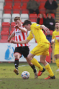 Kyle Storer and Matthew Robinson during the Vanarama National League match between Cheltenham Town and Woking at Whaddon Road, Cheltenham, England on 12 March 2016. Photo by Antony Thompson.