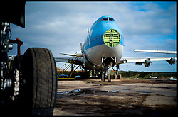 A 747 (blue) has had it's nose taken off as the dismantling process starts of the 747.Aeroplanes at Air Salvage International in Cirencester, Cotswold,United Kingdom, Friday, 15th November 2013. The Planes at the Aeroplane Scrapyard are taken apart for spare parts and scrap. In the air, A plane could be worth around £12.5M, But as parts it might be worth almost £19M. Almost everything on a modern airliner can be recycled, except the light bulbs and tyres. More than 40 planes are recycled at Air Salvage a year. Picture by Andrew Parsons / i-Images
