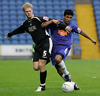 Photo: Dave Howarth.<br />Stockport County v Swansea City. The FA Cup.<br />05/11/2005. Harpal Singh (R) of Stockport takes on Alan Tate of Swansea