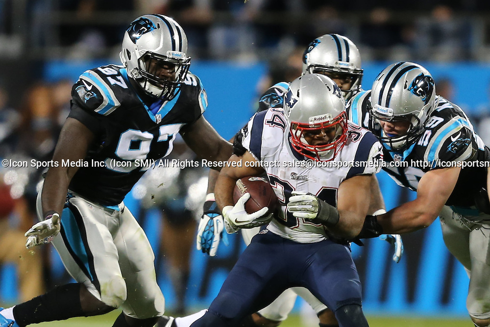 November 18, 2013: New England Patriots running back Shane Vereen (34) is surrounded by Carolina Panthers middle linebacker Luke Kuechly (59), and defensive end Mario Addison (97) during game action at Bank of America Stadium in Charlotte, NC. The Panthers win 24-20 over the Patriots.