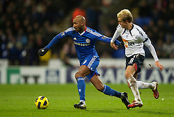 BOLTON, ENGLAND - Monday, January 24, 2011: Chelsea's Nicolas Anelka and Bolton Wanderers' Stuart Holden during the Premiership match at the Reebok Stadium. (Photo by David Rawcliffe/Propaganda)