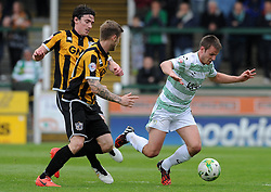 Yeovil Town's James Berrett  is tackled by Port Vale's Louis Dodds- Photo mandatory by-line: Harry Trump/JMP - Mobile: 07966 386802 - 25/04/15 - SPORT - FOOTBALL - Sky Bet League One - Yeovil Town v Port Vale - Huish Park, Yeovil, England.