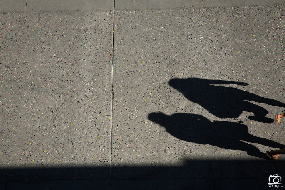 Shadows of students walking can be seen from the top of the Event Center at San Jose State University in San Jose, California, on August 22, 2014. (Stan Olszewski/SOSKIphoto)