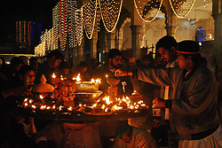 60860239<br /> Pakistanis light oil lamps at a shrine during the three-day celebrations of 969th Festival of Hazrat Ali Bin Usman, popularly known as Data Gunj Bakhsh, in eastern Pakistan's Lahore on Sunday, 22nd December 2013. Picture by imago / i-Images<br /> UK ONLY