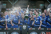 The FC Halifax Town players lift the promotion trophy after the Vanarama National League North Play Off final match between FC Halifax Town and Chorley at the Shay, Halifax, United Kingdom on 13 May 2017. Photo by Mark P Doherty.