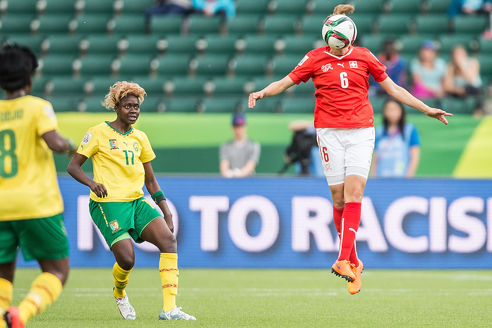 Switzerland's Selina Kuster  misses a header during Switzerland's FIFA Women's World Cup group C match against Cameroon at Commonwealth Stadium in Edmonton, Canada on June 16, 2015. Cameroon defeated Switzerland 2-1.  AFP PHOTO/GEOFF ROBINS
