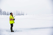 A Revelstoke Airport employee communicates via radio with the pilot of the first Revelstoke Air flight of the season on Jan. 12, 2018. The plane was re-routed to Kamloops due to poor visibility.