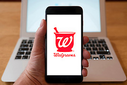 Using iPhone smartphone to display logo of Walgreens pharmacy chain