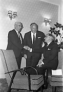 26/05/1962<br /> 05/26/1962<br /> 26 May 1962<br /> Urney staff presentation at the Central Hotel, Dublin. Mr George McMahon, (left) Senior Salesman, Urney Chocolates Ltd. presenting two fireside chairs on behalf of the sales staff to Mr Louis S. Bowers, who has retired from the company after 35 years service. Centre is Mr T.A. Headon, Managing Director. The presentation was made at a dinner given in honour of Mr Bowers by the company.