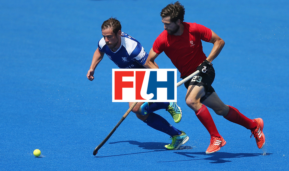 LONDON, ENGLAND - JUNE 20:  Gavin Byers of Scotland and Iain Smythe of Canada chase the ball during the Pool B match between Scotland and Canada on day six of the Hero Hockey World League Semi-Final at Lee Valley Hockey and Tennis Centre on June 20, 2017 in London, England.  (Photo by Alex Morton/Getty Images)