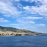 Strait of Messina in Messina, Italy<br /> From the town of Messina, there is only 3.2 miles of water separating the Island of Sicily from the tip of the boot of mainland Italia. For centuries, the Strait of Messina has been a channel for seagoing vessels and ferries.  It also welcomes about a half million cruise ship passengers each year. Although this channel is narrow, it has been the source of Greek myths for millenniums. Adorning the breakwater on the right is a golden Virgin Mary statue that the locals often call Madonnina.