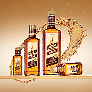 Royal Stag product range on a glass shelf with a swirl of whisky behind Ray Massey is an established, award winning, UK professional  photographer, shooting creative advertising and editorial images from his stunning studio in a converted church in Camden Town, London NW1. Ray Massey specialises in drinks and liquids, still life and hands, product, gymnastics, special effects (sfx) and location photography. He is particularly known for dynamic high speed action shots of pours, bubbles, splashes and explosions in beers, champagnes, sodas, cocktails and beverages of all descriptions, as well as perfumes, paint, ink, water – even ice! Ray Massey works throughout the world with advertising agencies, designers, design groups, PR companies and directly with clients. He regularly manages the entire creative process, including post-production composition, manipulation and retouching, working with his team of retouchers to produce final images ready for publication.