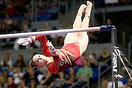 Urbandale's Rachel Gowey twists her way to the high bar Friday, June 24, 2016, as she competes in the uneven bars during the P&G Gymnastics Championships at Chaifetz Arena in St. Louis.