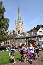 Norwich UK. 6th August 2017. 4700 people took part in the annual Run Norwich 10k road race organised by Norwich City FC Community Sports Foundation. Running round Cathedral Gardens