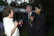 Mr. and Mrs. Algy Cluff. Cartier party after the preview of the Chelsea Flower show. physic Garden. London 21 May 2001. © Copyright Photograph by Dafydd Jones 66 Stockwell Park Rd. London SW9 0DA Tel 020 7733 0108 www.dafjones.com