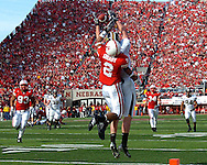 University of Nebraska defensive back Cortney Grixby (2) slaps the ball away from Missouri tight end Chase Coffman (45) in the fourth quarter at Memorial Stadium in Lincoln, Nebraska, November 4, 2006.  The Huskers defeated the Tigers 34-20.<br />