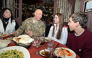 EDITORS NOTE: SERAFIN DECLINED TO IDENTIFY HIS FAMILY MEMBERS BY NAME: NEWTOWN, PA. - JANUARY 31: Chris Serafin, of Buckingham, Pennsylvania, who recently returned from 3 tours of duty in Afghanistan has dinner with his family January 31, 2015 at La Stalla Restaurant in Newtown, Pennsylvania. (Photo by William Thomas Cain/Cain Images)