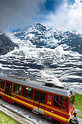 Jungfraubahn funicular train with Eiger Glacier, Eigergletscher, behind in Swiss Alps, Bernese Oberland, Switzerland
