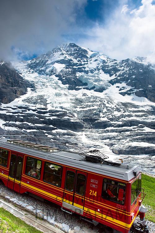 Jungfraubahn funicular train with Eiger Glacier, Eigergletscher, behind in Swiss Alps, Bernese Oberland, Switzerland