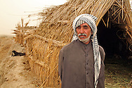 Patriarch of a Marshland Arab family living in a hut in Maysan Province, Iraq