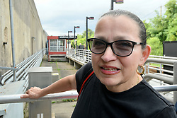 After departing the train Rose Delvicchio, of Collingswood, is one of the passengers helped with information about the upcoming temporary suspension for PTC installation on the Atlantic City Rail Line, at an information desk from NJ Transit, in Lindenwold, NJ, on Monday.