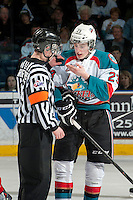 KELOWNA, CANADA - MARCH 22: Justin Kirkland #23 of the Kelowna Rockets speaks to the referee after a high stick cuts his lip on March 22, 2014 at Prospera Place in Kelowna, British Columbia, Canada.   (Photo by Marissa Baecker/Shoot the Breeze)  *** Local Caption *** justin Kirkland;