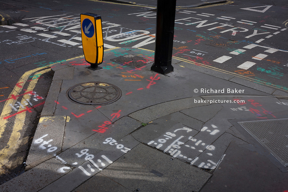 A street landscape of road junction construction markings in Soho, central London.