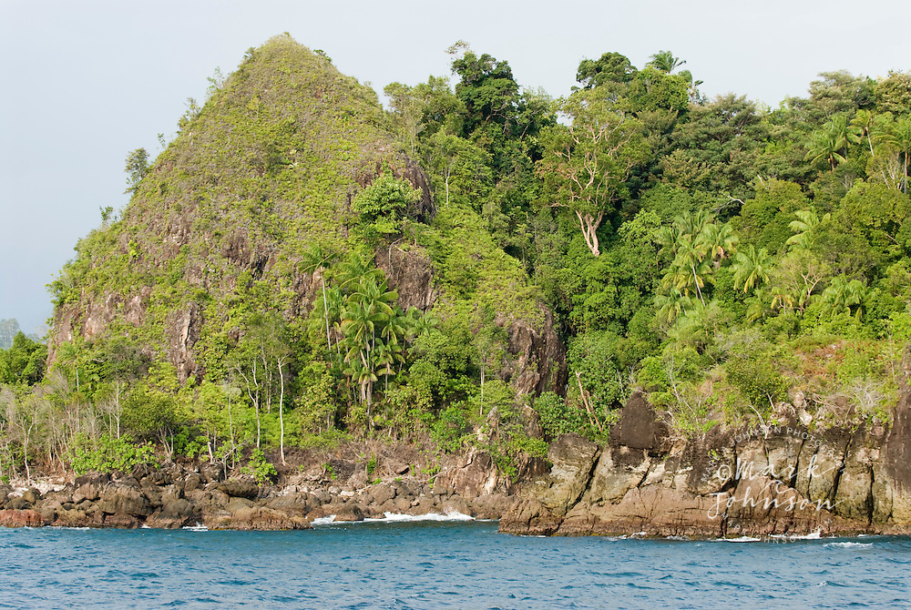 Forested coastline off the city of Padang, Sumatra, Indonesia