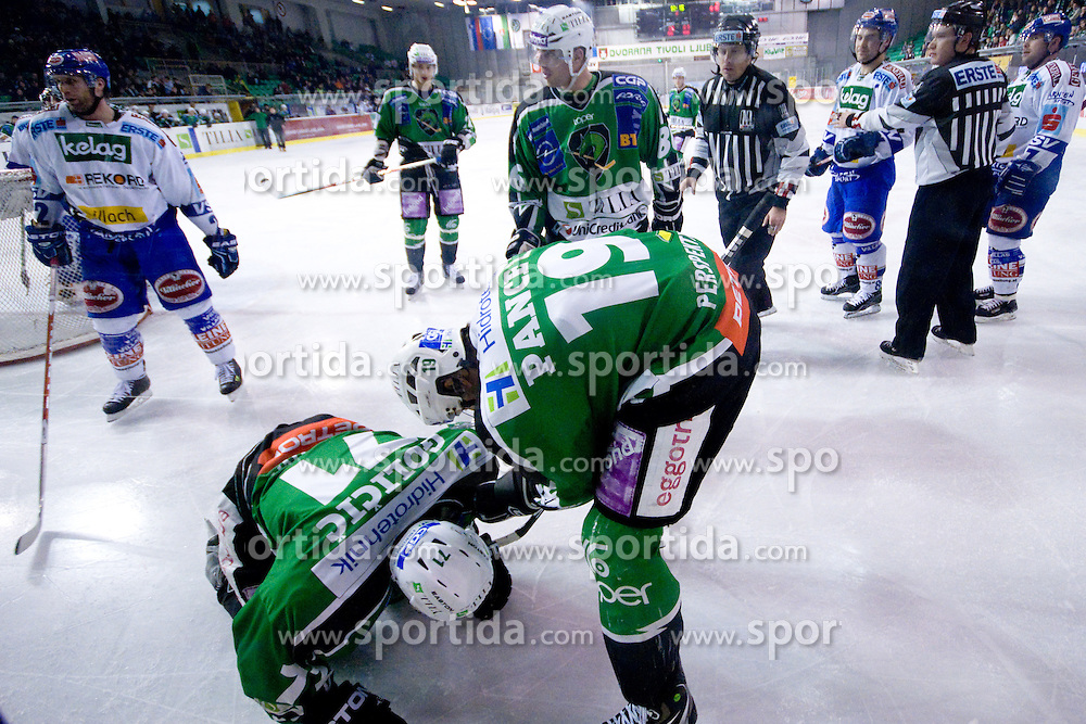 Bostjan Golicic (HDD Tilia Olimpija, #71) lying on the ice after boarding by Kevin Mitchell (EC Rekord-Fenster VSV, #7) during ice-hockey match between HDD Tilia Olimpija and EC Rekord-Fenster VSV in 46th Round of EBEL league, on Februar 6, 2011 at Hala Tivoli, Ljubljana, Slovenia. (Photo By Matic Klansek Velej / Sportida.com)
