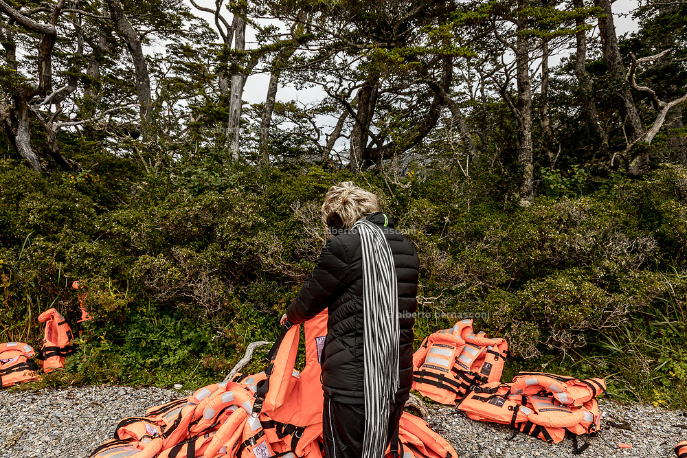Patagonia, cruising with Ventus Australis. excursion to Aguila Glacier. looking for the right life jacket