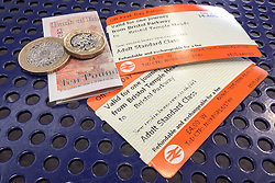 Embargoed to 0001 Thursday January 17 File photo dated 14/8/18 of off-peak day return rail tickets and money. A report by the House of Lords Economic Affairs Committee has warned students and rail passengers are being unfairly penalised by an openly-admitted error in the way a key measure of UK inflation is calculated.