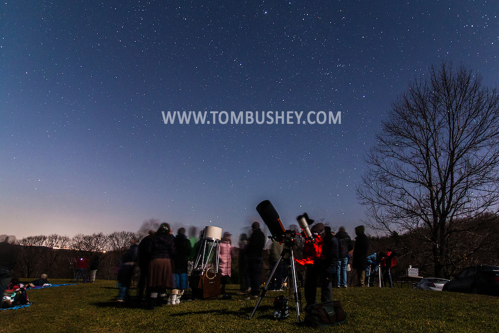 High Falls, New York - People join members of the Mid-Hudson Astronomical Association to view the moon and stars visible from the Spring Farm Trailhead at the Mohonk Preserve on Nov. 20, 2015.