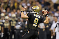28 November 2011: Quarterback (9) Drew Brees of the New Orleans Saints passes the ball against the New York Giants during the first half of the Saints 49-24 victory over the Giants at the Mercedes-Benz Superdome in New Orleans, LA.