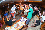 Egypt, Sinai, Red Sea Diving Safari Interior of the diving vessel the mess hall spontaneous party