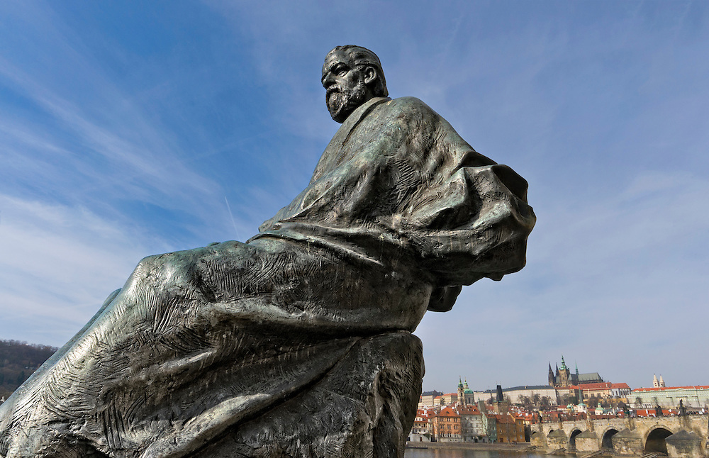 Bedrich Smetana Monument in Prague with Charles Bridge and Castle in the background.