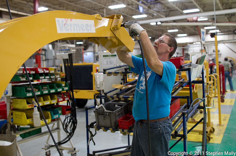An employee works on a brush chipper on the assembly line in Plant 4 at Vermeer in Pella, Iowa on Thursday, July 28, 2011.