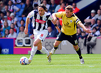 Photo: Leigh Quinnell.<br /> West Bromwich Albion v Barnsley. Coca Cola Championship. 06/05/2007. West Broms Jonathan Greening is held by Barnsleys Brian Howard.